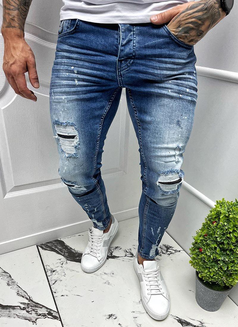 Мъжки сини дънки с кръпки разнищени